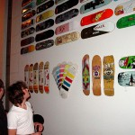 Huge wall of skateboard decks.