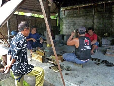 Men tuning metallophone keys at the gamelan foundry in Blahbatuh, Bali.
