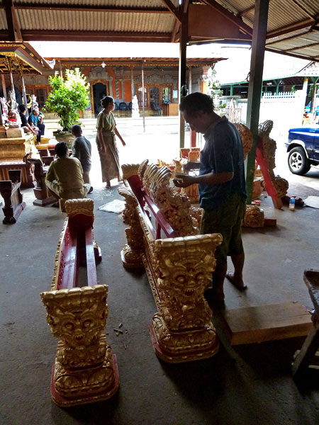 Painting actual gold, not paint, onto the instruments at the gamelan foundry in Blahbatuh, Bali.