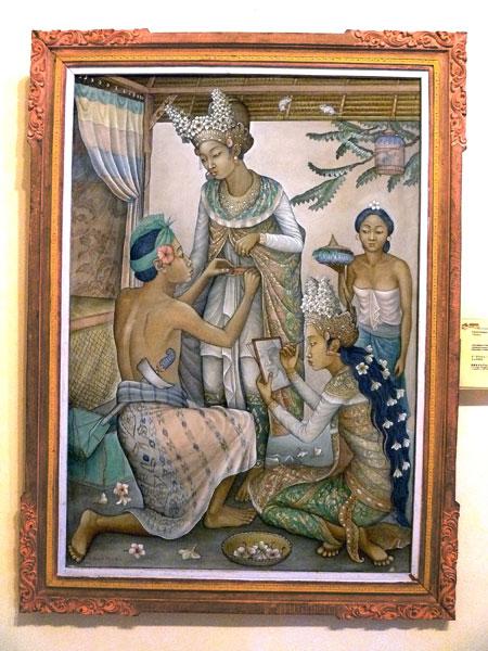 Dressing a dancer at the Agung Rai Museum of Art in Ubud, Bali.