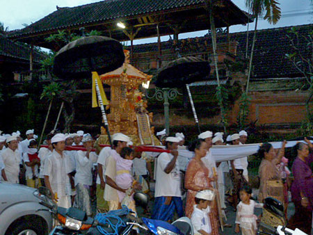 A Hindu religious procession in front of Bumbu Bali in Ubud, Bali.