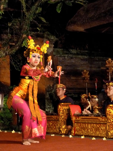 A member of the Sekehe Gong Panca Artha troupe performs the Legong dance at Ubud Palace in Ubud, Bali.