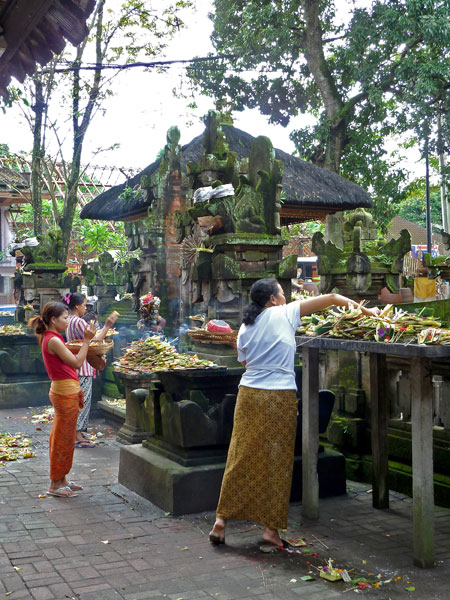 Offerings and prayer in Ubud, Bali.