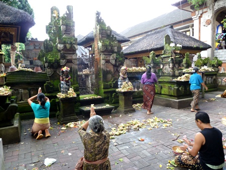 Offerings and prayer, Ubud, Bali.