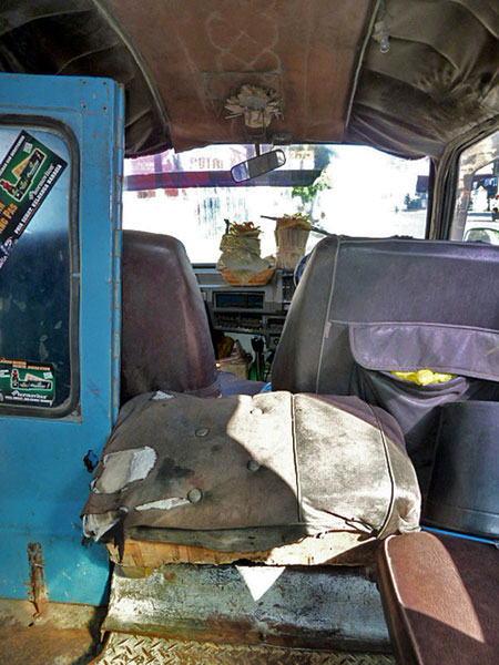 Looking out the front of a battered old bemo in Denpasar, Bali.