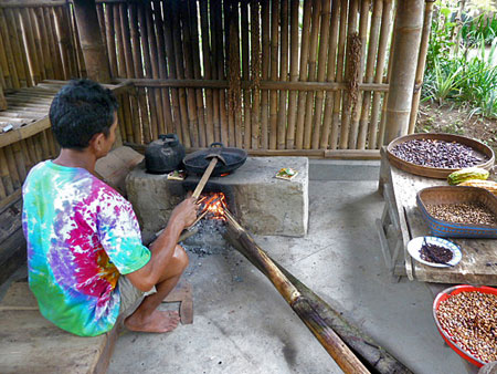 Processing locally grown coffee beans in Bali.