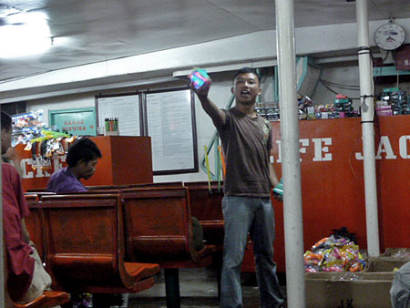 An entertaining hawker on the ferry between Bali and Java.