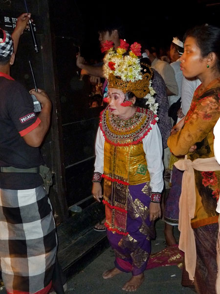 A Galuh dancer in the staging area at Pura Dalem Puri in Peliatan, Bali.