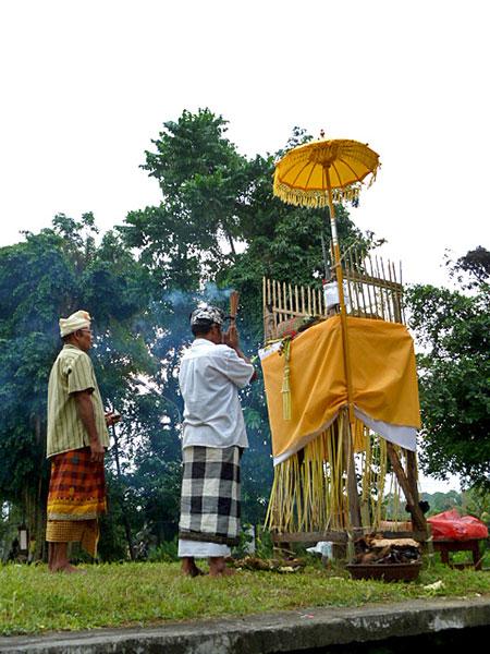 Saying a prayer at Pura Dalem Puri in Peliatan, Bali.