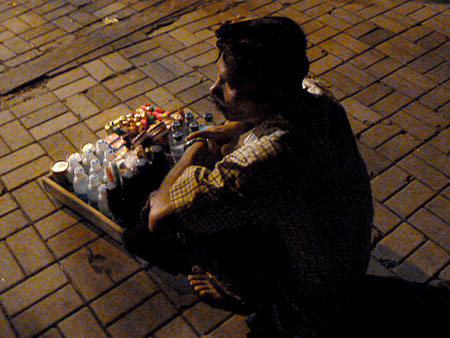 Snack vendor at Pura Dalem Puri in Peliatan, Bali.