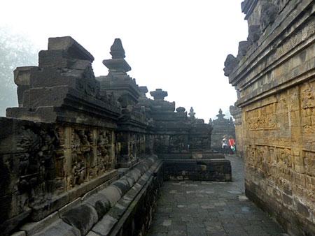 Circumnambulating at the bottom level at Borobudur near Magelang, Central Java.