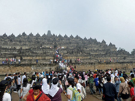 The tour bus throngs arrive at Borobudur near Magelang, Central Java.