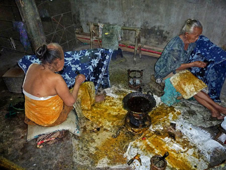 Traditional batik making with wax in Solo, Java.