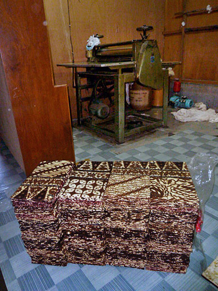 Stacks of traditional batik at a factory in Solo, Java.