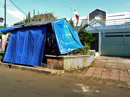 A typical plastic covered food stall in Solo, Java. Usually set up in slums, these things look really gloomy at night.