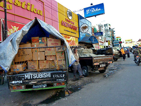 A truck crammed full of boxes in Solo, Java.