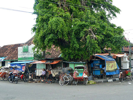 Some shanty stalls across the street from the Sultan's Palace in Yogyakarta, Java.