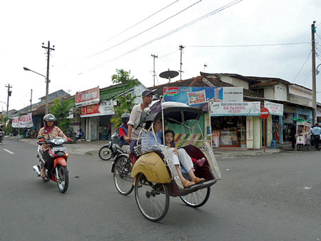 Cruising in a becak in Yogyakarta, Java.