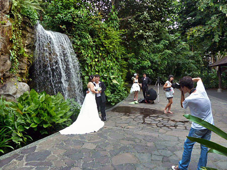 One of many newlywed portraits shot in front of the waterfalls in the Singapore Botanic Gardens.