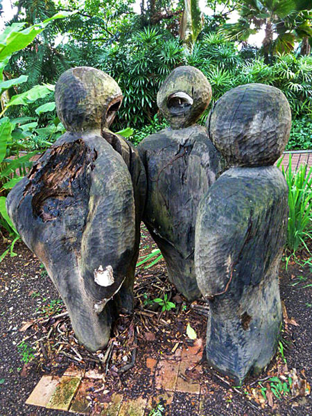 A trio of wood sculptures in Fort Canning, Singapore.