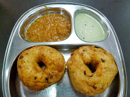 A pair of lentil-donuts at Komas Vilas in Little India, Singapore.