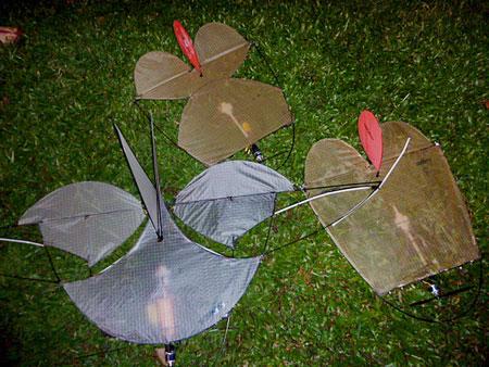 A trio of radio-controlled kites at Clarke Quay, Singapore.