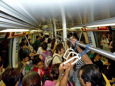A busy night on the subway in Singapore.