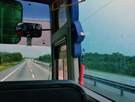 Cruising on the bus down the deluxe highway from Singapore to Melaka, Malaysia.