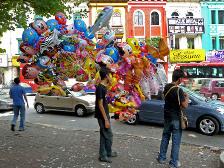An explosion of colorful balloons in Little India, Kuala Lumpur, Malaysia.
