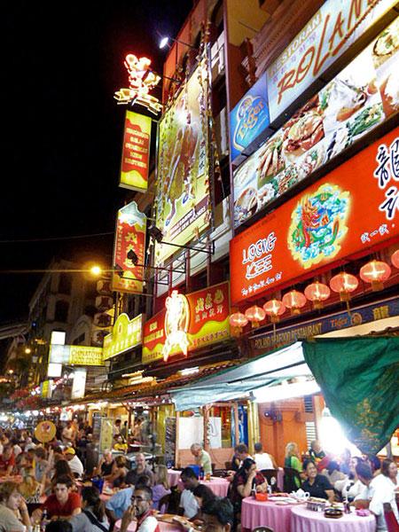 Some bright signs blaze through the night in Chinatown, Kuala Lumpur, Malaysia.