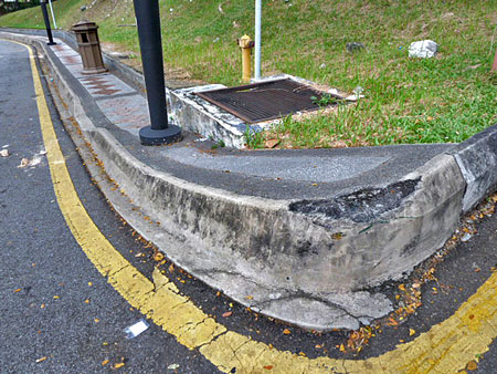 This sidewalk is so steep, you could easily drop in on it. Kuala Lumpur, Malaysia.