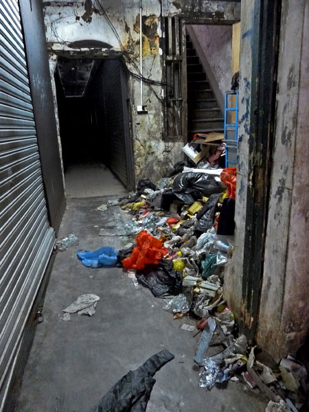 A big pile of random hallway trash right by my favorite alley food stall in Chinatown, Kuala Lumpur, Malaysia.