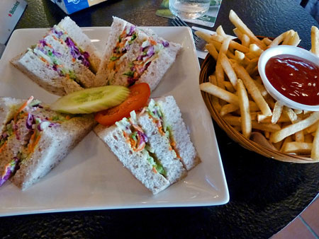A cole slaw sandwich and French fries at The Geographer cafe in Chinatown, Melaka, Malaysia.