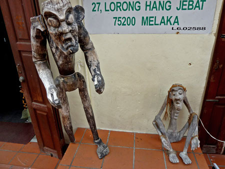 A couple of grumpy locals in Chinatown, Melaka, Malaysia.