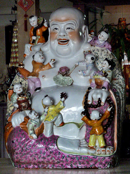 A happy Buddha in Chinatown, Melaka, Malaysia.