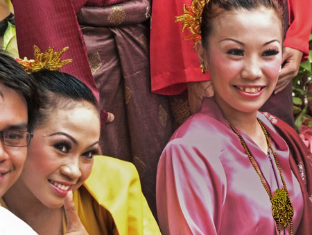 A couple of Malaysian beauties brighten an overcast day in Town Square, Melaka, Malaysia.