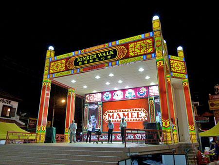 The massive Jonker Walk kaoroke stage illuminates the night market in Chinatown, Melaka, Malaysia.