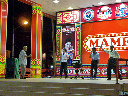 A group of grandpas pump up the crowd at the night market in Chinatown, Melaka, Malaysia.