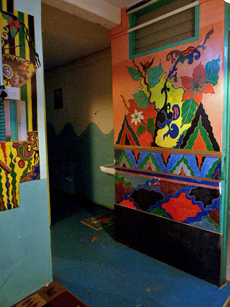Some nice, colorful paintings adorn the walls of Shirah's Guest House in Melaka, Malaysia.