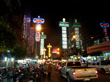 Just a small section of Chinatown beckons fans of color and light in Bangkok, Thailand.