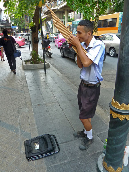 Some kid pipes away on the khaen in Bangkok, Thailand.