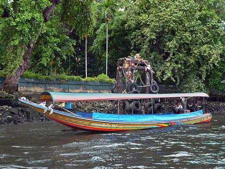 A longtail boat on the Chao Phraya river in Bangkok, Thailand.