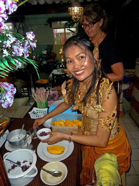 The lovely May Kaidee herself, serving guests at her vegetarian restaurant in Banglamphu, Bangkok, Thailand.
