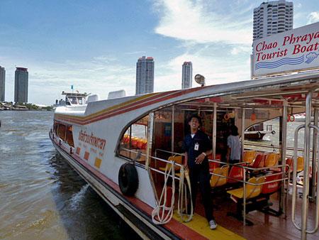 The Chao Phraya river taxi leaves Banglamphu, Bangkok, Thailand.