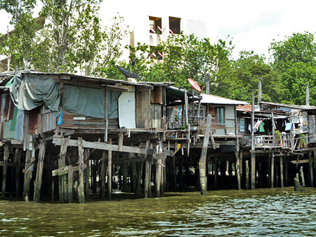 A standard shanty town on the Chao Phraya river in Bangkok, Thailand.