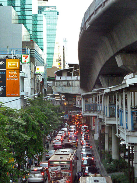 The ever-present Bangkok traffic snarls, barks and occasionally meows under the Skytrain.