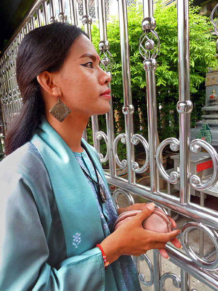 A beauty graces a gate at the Sri Mariamman Temple in Bangkok, Thailand.