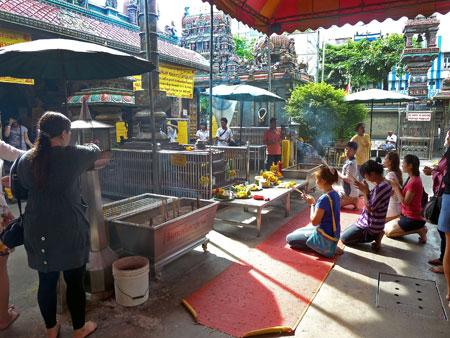Devotees pray at the Sri Mariamman Temple in Bangkok, Thailand.