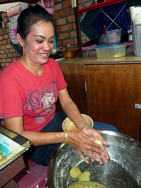 As Thai as they come, Aoi prepares pancake batter in her food stall on Ko Phi Phi Don, Thailand.