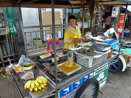 This lady sold me yummy fried bananas on a stick in Phuket Town, Thailand.